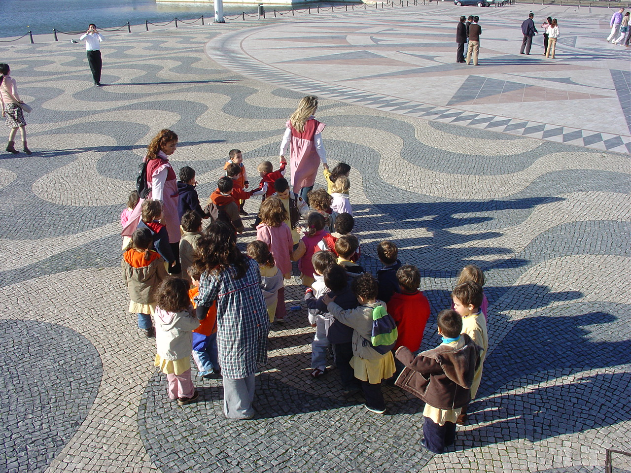 Pre-school children stroll in the wind rose